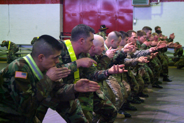 SGT. 1ST Class Manstran, SGT. O'Donnell, SGT. Hickey, 2nd LT. Grow, SPC. Bosold, PFC. Kemper, SGT. Plew, SGT. Pace, and others go through drills to earn their spurs. They are from 1ST Armored Division, 1ST U.S. Cavalry Regiment and are participating in a Spur Ride held April 3 and 4, 2006 in Buedingen Germany. (U.S. Army photo by Martin Greeson) (Released)