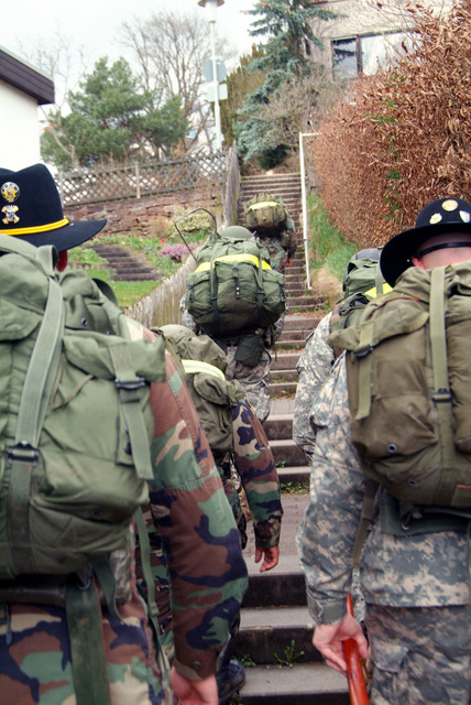 Team 4 starts up the hill in Buedingen to their first challenge. There are over 200 steps to climb which they learned by coming back down and counting while carrying a steel weight. They are from 1ST Armored Division, 1ST U.S. Cavalry Regiment and are participating in a Spur Ride held April 3 and 4, 2006 in Buedingen Germany. (U.S. Army photo by Martin Greeson) (Released)