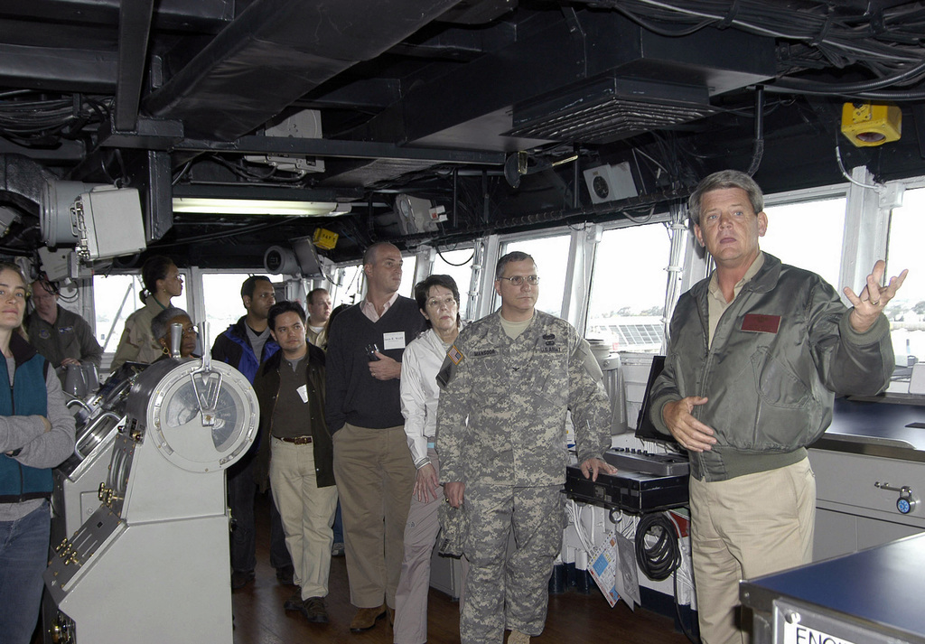 US Navy (USN) Captain (CAPT) William Hamilton (right), talks with members from the Council on Foreign Relations (CFR), as they tour the bridge of the USN Austin Class Amphibious Assault Ship, USS DUBUQUE (LPD 8), while in port at Navy Base San Diego, California (CA). The tour highlighted the DUBUQUEs mission, training, technology and amphibious operations. CFR is a nonprofit organization dedicated to producing and disseminating ideas to members and policymakers to better understand world policy facing the US and other governments