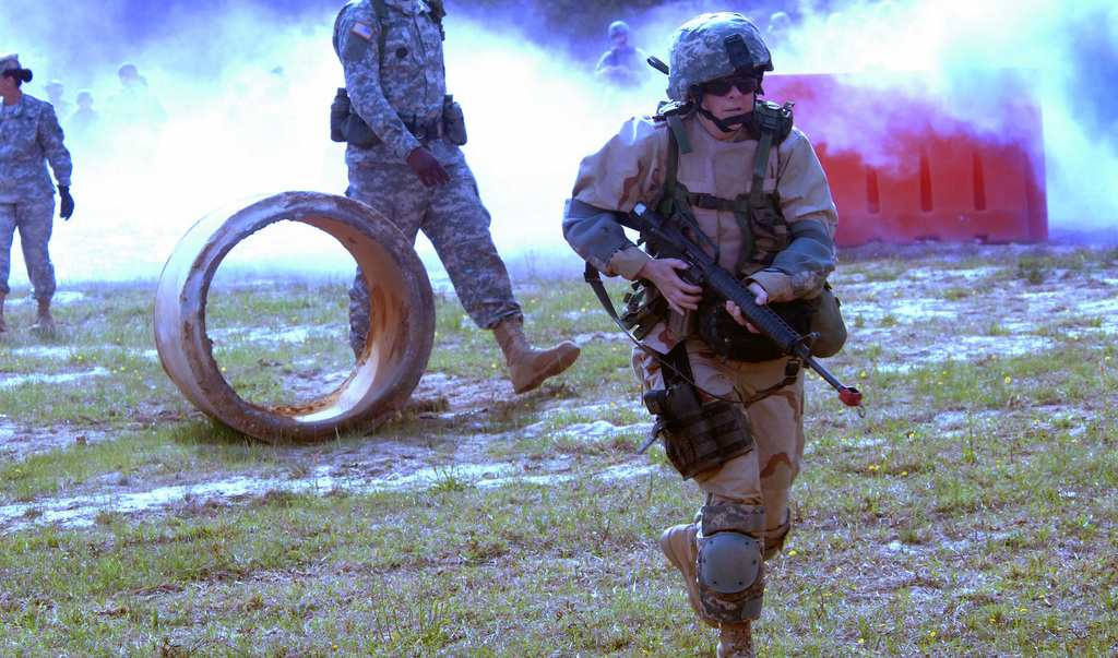 A US Navy (USN) Reservist rushes through a simulated battlefield during the US Navy's (USN) Individual Augmentee Combat Training (IACT) course at Fort Jackson, South Carolina (SC). The fast-paced, two-week course is instructed by US Army (USA) drill sergeants and designed to provide Sailors basic combat skills training prior to being deployed as individual augmentees to the US Central Command (USCENCOM) area of responsibility