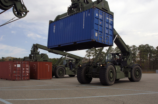 US Navy (USN) Sailors assigned to Naval Expeditionary Logistics Support Group (NELSG) Delta, train using the Kalmar RT 240 Rough Terrain Container Handlers (RTCH), at Fort Eustis, Virginia (VA)