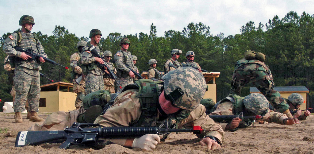 US Navy (USN) Sailors hit the dirt with their Colt 5.56 mm M16A1 rifles by their side during the USN Individual Augmentee Combat Training (IACT) course at Fort Jackson, South Carolina (SC). The fast-paced, two-week course is instructed by US Army (USA) drill sergeants and designed to provide Sailors basic combat skills training prior to being deployed as individual augmentees to the US Central Command (USCENCOM) area of responsibility