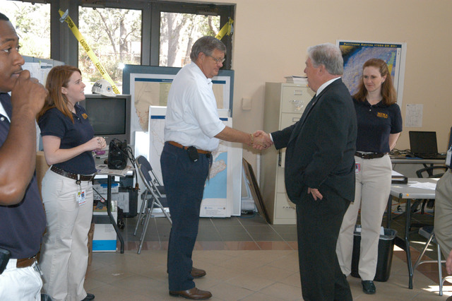 [Hurricane Katrina] Biloxi, Miss., April 6, 2006 - John Crowley, FEMA Chief of Staff, greets Governor Haley Barbour as he enters the MEMA/FEMA Joint Field Office (JFO) this morning for a visit before a joint press conference this afternoon, as Lea Stokes, MEMA Public Relations Director, and Ashley Roth, MEMA Public Information Coordinator, stand by.  The state and FEMA are partners in preparation for the new hurricane season as well as in recovery efforts from Hurricane Katrina.  George Armstrong/FEMA