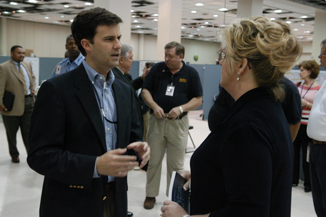 [Hurricane Katrina] Biloxi, Miss., April 6, 2006 - Mary Lynne Miller, acting FEMA Regional Director, Region IV, discusses recovery efforts with Brian Sanderson, Deputy Director, Governor's Office of Recovery and Renewal, during the Governor's visit to the MEMA/FEMA Joint Field Office (JFO) today. The state and FEMA are working together to overcome the impact of Hurricane Katrina.  George Armstrong/FEMA