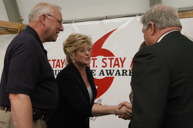 """[Hurricane Katrina] Biloxi, Miss., April 6, 2006 - Mary Lynne Miller, FEMA acting Region IV Director, and Governor Haley Barbour, as well as MEMA Director, Robert Latham have just finished their presentations at the """"Stay Alert, Stay Alive, Hurricane Awareness 2006"""" kickoff campaign at the Salvation Army's """"Yankie Stadium"""" disaster center.  FEMA is a partner with the state in preparation for the 2006 hurricane season.  George Armstrong/FEMA"""