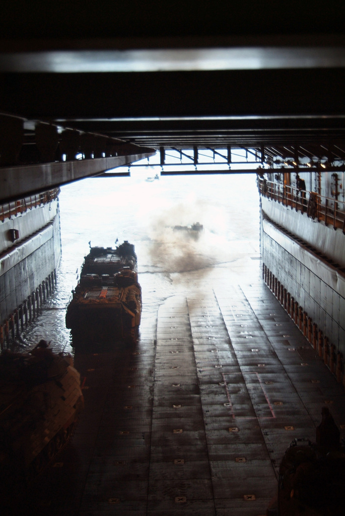 US Marine Corps (USMC) Amphibious Assault Vehicles (AAV7A1) from the 31st Marine Expeditionary Unit (MEU), exit the well deck of the US Navy (USN) Dock Landing Ship USS HARPERS FERRY (LSD 49), during an amphibious landing exercise near the beach at Okinawa, Japan (JPN). Commander, Task Force 76 (CTF-76) ships, units and embarked 31st MEU elements are returning from operations supporting Reception, Staging, Onward Movement and Integration (RSOI) and Exercise FOAL EAGEL 2006. The Exercise is designed to strengthen interoperability between the US and the Republic of Korea (ROK)