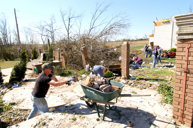 [Severe Storms and Tornadoes] Marmaduke, Ar. -- A volunteer cleans up rubble from the open area that is left after a tornado destroyed the home that once occupied the space.  This community is only one of many that had damages caused by storms and tornaoes that swept across central and norhtestern Arkansas between April 1st and 3rd.  FEMA photo by Win Henderson