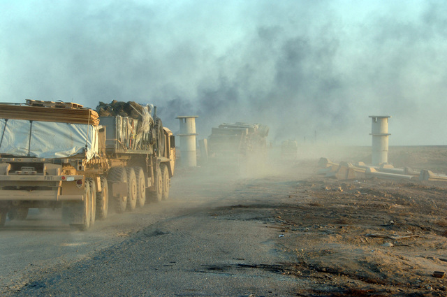 A U.S. Army convoy from F Company, 1-68th Combined Arms Battalion, 4th Infantry Division carries supplies to a future traffic control point area near by a brick factory in Narwan, Iraq on April 10, 2006.  The 4th Infantry Division is currently deployed in Iraq supporting Operation Iraqi Freedom. (U.S. Army photo by SPC. Teddy Wade) (Released)