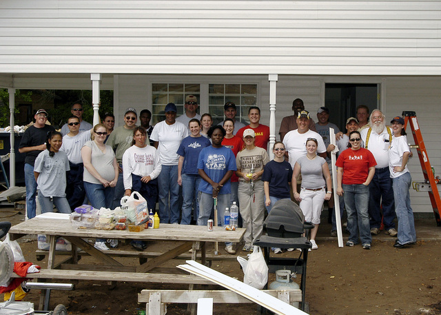 US Navy (USN) Sailors assigned to the Navy Operational Support Center (NOSC), Habitat for Humanity coordinators and Maliza Wilson the future house owner pose for a group photo, after a long day's work. This Habitat for Humanity volunteer effort builds houses for low-income families in Jacksonville, Florida (FL). Twenty-seven NOSC Jacksonville Sailors volunteered for this worthy cause