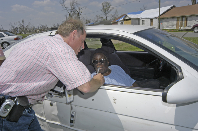 [Severe Storms, Tornadoes, and Flooding] Caruthersville, MO. 4-13-06  Herb Cohen, a Home Inspection contractor for FEMA talks to Olga King, whose home was damaged by the tornado that hit the town. Hundreds of homes damaged by the tornado and there were no serious injuries or deaths reported. FEMA is working with local and State agencies. Photo by Patsy Lynch/FEMA