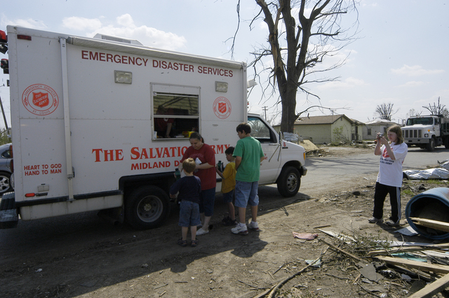 [Severe Storms, Tornadoes, and Flooding] Caruthersville, MO, 4-15-06 -- Residents of Caruthersville, Mo accept food from a Salvation Army disaster relief truck. A Salvation Army volunteer takes a photo of the action.  Photo by Patsy Lynch/FEMA