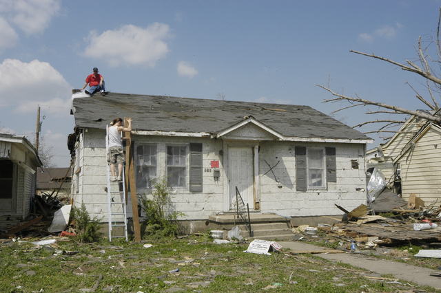 [Severe Storms, Tornadoes, and Flooding] Caruthersville, MO. 4-15-06 -- These residents of Caruthersville are repairing their home that was damaged by the tornado that swept through the town.  Photo by Patsy Lynch/FEMA