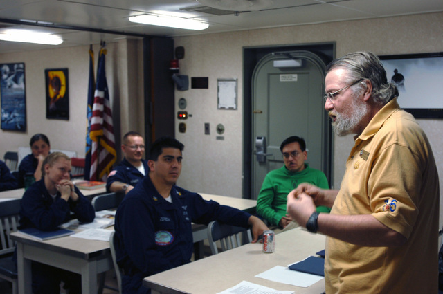 US Naval College Program for Afloat College Education instructor Sam Taylor teaches a US History class aboard the USN Nimitz Class Aircraft Carrier USS RONALD REAGAN (CVN 76). The REAGAN and its embarked Carrier Air Wing 14 (CVW-14) are currently deployed in the Persian Gulf on a routine rotation of US maritime forces in support of the global war on terrorism