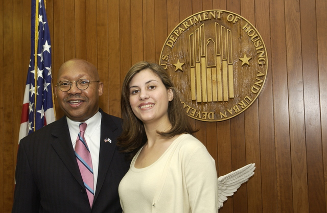 Secretary Alphonso Jackson with Schedule C Staff - Secretary Alphonso Jackson posing with series of Schedule C staff members, including Lisa Schlosser, Scott Knittle, Emily Newlin, Sarah Keith, Philip Levis, and Major Hank Holiday, at HUD Headquarters