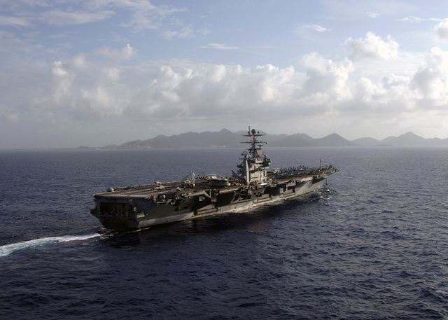 The US Navy (USN) Nimitz Class Aircraft Carrier USS GEORGE WASHINGTON (CVN 73) prepares to drop anchor off the coast of Saint Maarten, near the Netherlands Antilles (ANT) and enjoy a four-day port visit. GEORGE WASHINGTON Carrier Strike group is currently participating in Partnership of the Americas, a maritime training and readiness deployment of the US Naval Forces with Caribbean and Latin American countries in support of the US Southern Command's (SOUTHCOM) objectives for enhanced maritime security