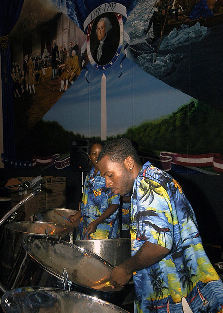 A Saint Maarten, Netherlands Antilles (ANT), band provides entertainment for Consul General guests, Navy League and the US Navy (USN) Nimitz Class Aircraft Carrier USS GEORGE WASHINGTON (CVN 73) Sailors (not shown), during a reception aboard the USN Nimitz Class Aircraft Carrier