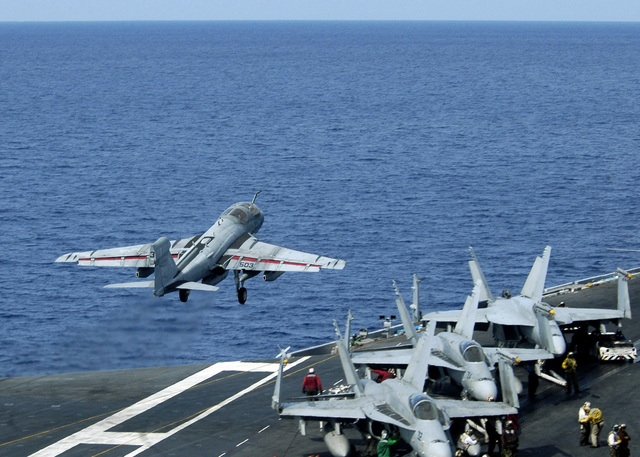 """A US Navy (USN) EA6-B Prowler aircraft attached to """"Lancers"""" Electronic Attack Squadron 131 (VAQ 131) launches during flight operations on the USN Nimitz Class Aircraft Carrier USS ABRAHAM LINCOLN (CVN 72). The LINCOLN and its embarked Carrier Air Wing 2 (CVW 2) are currently underway to the Western Pacific for a scheduled six-month deployment"""