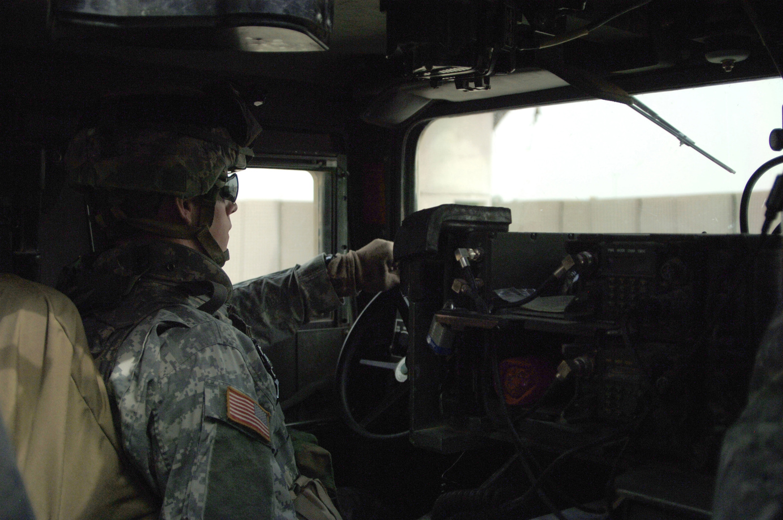 U.S. Army PFC. Albert Shy from A battery 3rd battalion, 320th Field Artillery Regiment, 101st Airborne Division drives a High Mobility Multi-Purpose Wheeled Vehicle (HMMWV) during a convoy operation out of Forward Operation Base Remagen, Iraq on April 16, 2006.   Currently the 3rd Brigade, 101st Airborne Division is deployed in Iraq supporting Operation Iraqi Freedom.(U.S. Army photo by SPC. Teddy Wade) (Released)