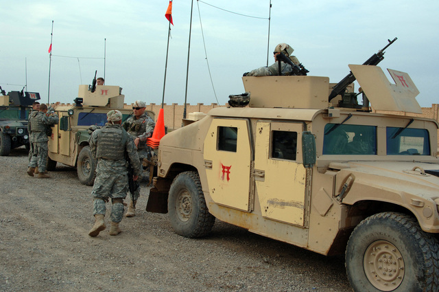 U.S. Army Soldiers from B battery, 3rd Battalion, 320th Field Artillery Regiment, 101st Airborne Division prepare to go out on a mission in Forward Operation Base Remagen Iraq on April 18, 2006. The 101st Airborne Division is currently deployed in the Tikrit area and Northern Iraq on support of Operation Iraqi Freedom. (U.S. Army photo by SPC. Teddy Wade) (Released)