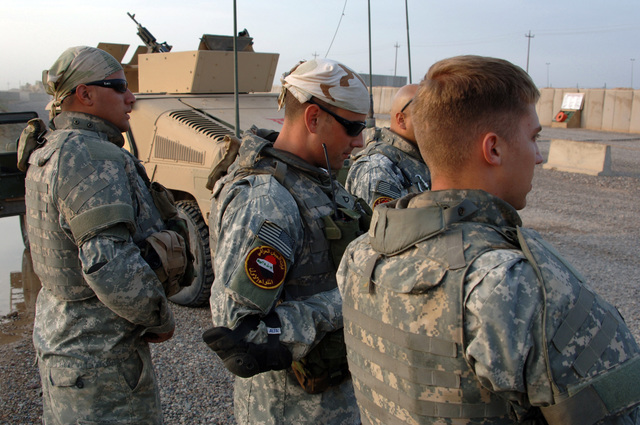 U.S. Army Soldiers from B battery, 3rd Battalion, 320th Field Artillery Regiment, 101st Airborne Division listen a safety briefing before going out on a mission in Forward Operation Base Remagen Iraq on April 18, 2006. The 101st Airborne Division is currently deployed in the Tikrit area and Northern Iraq on support of Operation Iraqi Freedom. (U.S. Army photo by SPC. Teddy Wade) (Released)