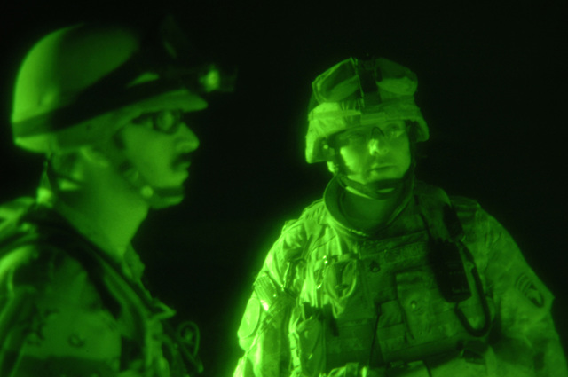 U.S. Army STAFF SGT. Cesar Sanchez from B battery, 3rd Battalion, 320th Field Artillery Regiment, 101st Airborne Division supervises an Iraqi soldier interrogating a civilian during a joint patrol operation in the western desert area of Tikrit, Iraq on April 18, 2006. The 101st Airborne Division is currently deployed in the Tikrit area and Northern Iraq on support of Operation Iraqi Freedom. (U.S. Army photo by SPC. Teddy Wade) (Released)