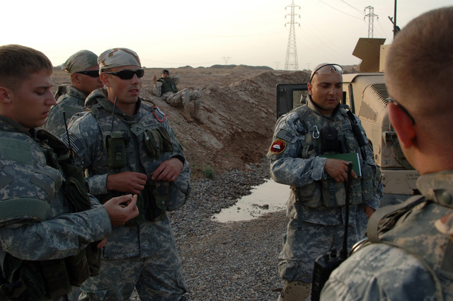 U.S. Army STAFF SGT. Cesar Sanchez from B battery, 3rd Battalion, 320th Field Artillery Regiment, 101st Airborne Division offers a safety briefing to his troops before going out on a mission in Forward Operation Base Remagen Iraq on April 18, 2006. The 101st Airborne Division is currently deployed in the Tikrit area and Northern Iraq on support of Operation Iraqi Freedom.(U.S. Army photo by SPC. Teddy Wade) (Released)