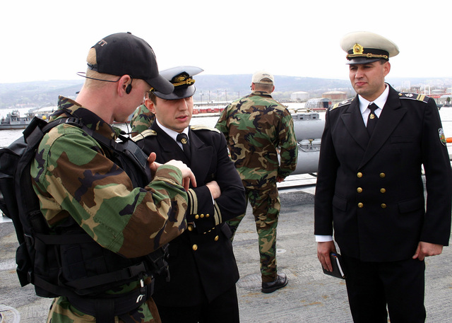 Onboard the US Navy (USN) Arleigh Burke Class (Flight IIA) Guided Missile Destroyer (Aegis), USS PORTER (DDG 78), a USN Sailors assigned to the ships Visit, Board, Search and Seizure (VBSS) Team, discusses tactics with two Bulgarian Navy Sailors, during bilateral training on the destroyer's aft missile deck. The PORTER is in port at Varna, Bulgaria, engaged in maneuvering, communication, air defense and Maritime Interdiction Operations (MIO) drills, to strengthen the emerging partnership between the two navies