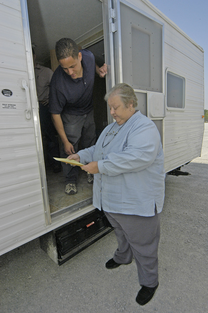 [Severe Storms, Tornadoes, and Flooding] Caruthersville, MO, 4-19-06 -- Diane Sayre, the mayor of Caruthersville, MO discusses the shipping contract for manufactured homes with John Allison, the FEMA site manager. The manufactured homes are being brought to Caruthersville, MO to provide temporary housing for residents whose homes were damaged by a tornado that hit the town on April 2, 2006.  Photo by Patsy Lynch/FEMA