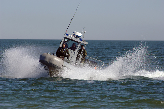 US Navy (USN) Sailors assigned to Mobile Security Detachment Two Three (MSD-23), aboard a USN 25-foot Secure All-Around Floatation Equipped (SAFE) Boat, patrol the waters of the Atlantic Ocean, just off shore, during a field training exercise on the beach at Naval Amphibious Base (NAB) Little Creek, Virginia (VA). The exercise prepares MSD-23 for deployment type scenarios