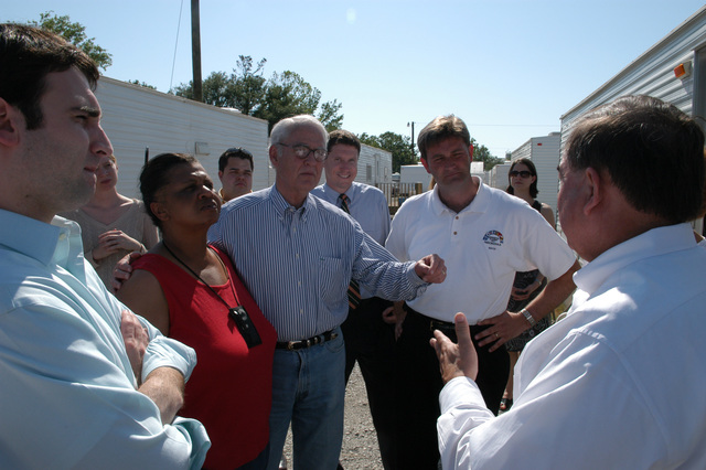 [Hurricane Katrina] Pascagoula, Miss., April 20, 2006 - At a FEMA mobile home site, US Department of Homeland Security Chairman of Gulf Coast Rebuilding, Don Powell (center), speaks with FEMA Deputy Federal Coordinating Officer (DFCO), Jesse Munoz (right) as Mayor Matthew Avara (in white), Willie Monroe, FEMA Recertification worker, and others of Mr. Powell's staff observe.  Mr. Powell and staff are here on tour of the Gulf disaster area.  George Armstrong/FEMA