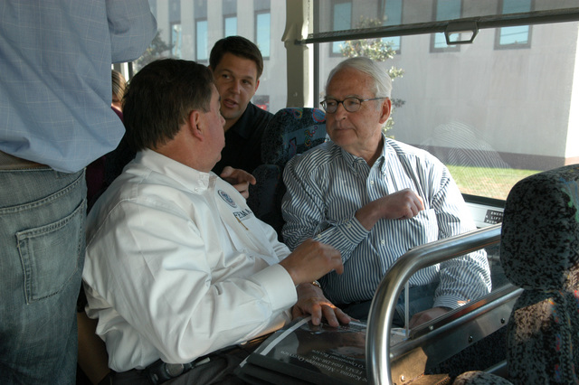 [Hurricane Katrina] Pascagoula, Miss., April 20, 2006 - While traveling on the tour bus, FEMA Deputy Federal Coordinating Officer, Jesse Munoz confers with Don Powell, Chairman, US Homeland Security Gulf Coast Rebuilding, and his chief of staff, Jodey Arrington.  Mr. Powell and staff are on a tour of the Gulf coast disaster area.  George Armstrong/FEMA