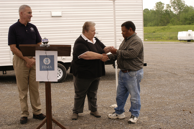 [Severe Storms, Tornadoes, and Flooding] Caruthersville, MO, 4-20-06 -- FEMA FCO Tom Costello looks on as  Mayor Diane Sayre of Caruthersville, MO., hands Billy Joe Cobb the key to his new manufactured home.  Mr Cobb lost his home when a tornado hit the town. Photo by Patsy Lynch/FEMA