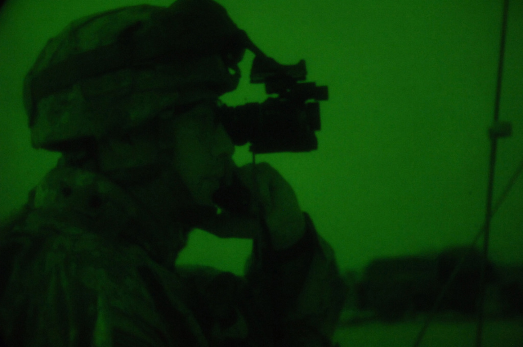 U.S. Army Radio Operater, SPC. Fred Burch from Charlie Company, 1ST Battalion, 187th Infantry Regiment, 101st Airborne Division establishes communications with other elements in the field during an air assualt mission into Al Mara, Iraq on April 23, 2006.  The air assualt was part of Operation Swift Sword, a mission to root out Anti-Iraqi Forces, weapons caches and possible training camps.  (U.S. Army photo by SPC. Charles W. Gill) (Released)