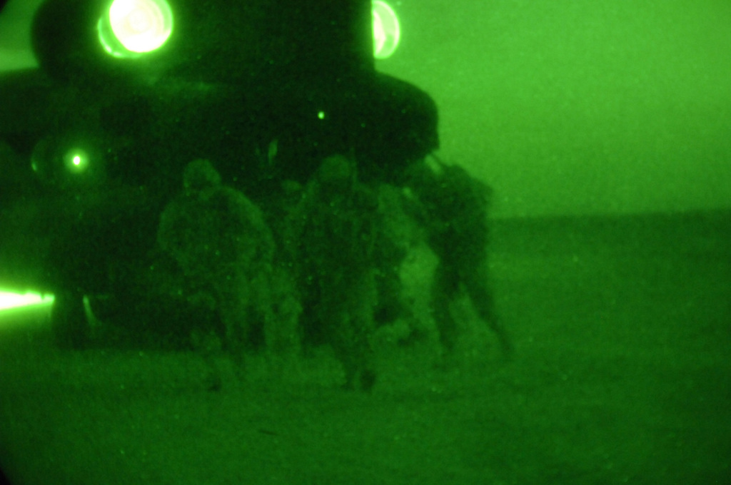 U.S. Army Soldiers from Charlie Company, 1ST Battalion, 187th Infantry Regiment, 101st Airborne Division exit a CH-47 Chinook Helicopter during an air assualt mission into Al Mara, Iraq on April 23, 2006.  The assualt was part of Operation Swift Sword, a mission to root out Anti-Iraqi Forces, weapons caches and possible training camps.  (U.S. Army photo by SPC. Charles W. Gill) (Released)