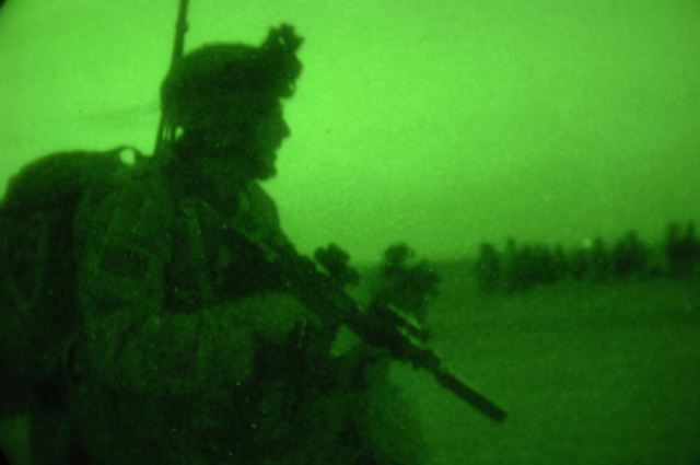U.S. Army SPC. Fred Burch from Charlie Company, 1ST Battalion, 187th Infantry Regiment, 101st Airborne Division takes a security position during an air assualt mission into Al Mara, Iraq on April 23, 2006.  The assualt was part of Operation Swift Sword, a mission to root out Anti-Iraqi Forces, weapons caches and possible training camps.  (U.S. Army photo by SPC. Charles W. Gill) (Released)
