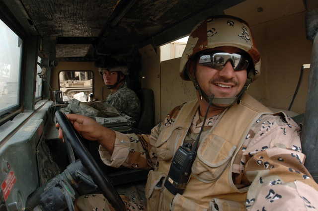 An Iraqi soldier operates a High Mobility Multi-Purpose Wheeled Vehicle (HMMWV) during a driver's training conduct by soldiers from B Battery, 3-320th Field Artillery Regiment 101st Airborne Division at Forward Operating Base Remagen in Tikrit, Iraq on April 24, 2006.    The 101st Airborne Division is currently deployed in the Tikrit area and Northern Iraq on support of Operation Iraqi Freedom.(U.S. Army photo by SPC. Teddy Wade) (Released)
