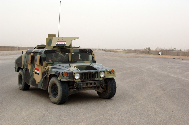 U.S Army Soldiers from B Battery, 3-320th Field Artillery Regiment 101st Airborne Division conduct a driver's training with Iraqi Soldiers at Forward Operating Base Remagen in Tikrit, Iraq on April 24, 2006. The 101st Airborne Division is currently deployed in the Tikrit area and Northern Iraq on support of Operation Iraqi Freedom.(U.S. Army photo by SPC. Teddy Wade) (Released)