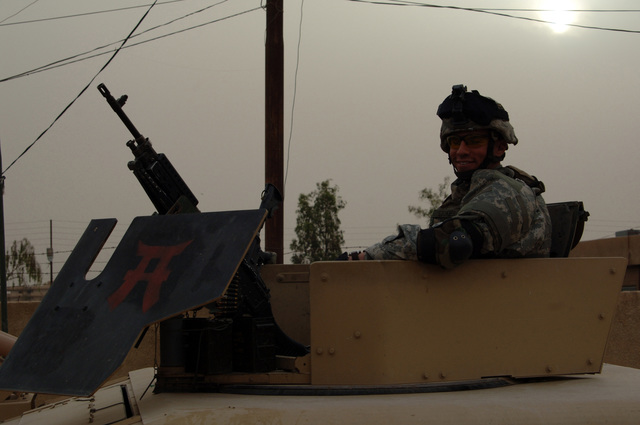 U.S. Army SPC. Josh Stokes a gunner from B Battery , 3-320th Field Artillery Regiment 101st Airborne Division provide security during a patrol in the streets of Osha City,Tikrit on April 24, 2006.    The 101st Airborne Division is currently deployed in the Tikrit area and Northern Iraq on support of Operation Iraqi Freedom.(U.S.. Army photo by SPC. Teddy Wade) (Released)