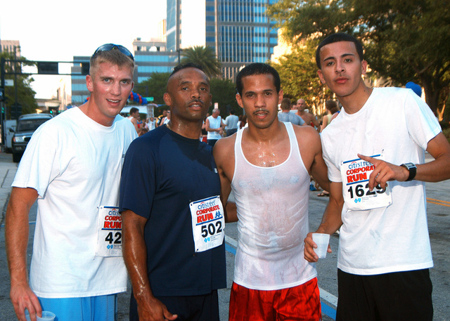 Four US Navy (USN) Sailors from the USN Nimitz Class Aircraft Carrier, USS JOHN F KENNEDY (CV 67), pose for a group photograph after they were the first to cross the finish line, during the Citistreet 5K Corporate Charity Run competition held in Jacksonville, Florida (FL). The event drew more than 2,000 participants with the proceeds going to the Blue Cross and Blue Shield Northeast Child Abuse Prevention Program. Pictured left-to-right: USN Hospital Corpsman Third Class (HM3) Jon Grooms; CHIEF Culinary Specialists (CSC) Tyrone Thomas; Ships Serviceman Second Class (SH2) Yernando Chipi and Store Keeper Third Class (SK3) Jose Arredondo