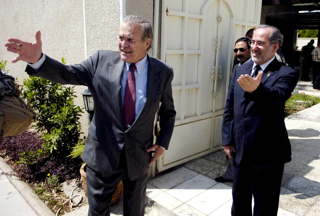 The Honorable Donald H. Rumsfeld (left), U.S. Secretary of Defense, and Iraqi National Security Advisor Muwaffak Rubaie (right), gesture after a meeting with Iraqi Ministry of Interior senior officials in Baghdad, Iraq, on April 27, 2006. (DoD photo by PETTY Officer 1ST Class Chad J. McNeeley) (Released)