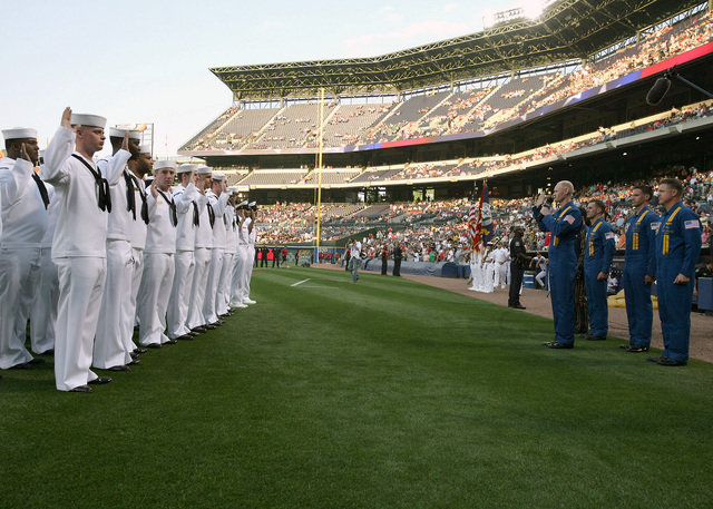 US Navy (USN) Sailors from the Naval Recruiting District, Atlanta, Georgia (GA), recite the oath of enlistment being given by USN Lieutenant (LT) Anthony Walley, a member of the USN Blue Angels Flight Demonstration Team before the start of a Major League Baseball (MLB) Atlanta Braves Baseball Game, at Turner Field in Atlanta, (GA)
