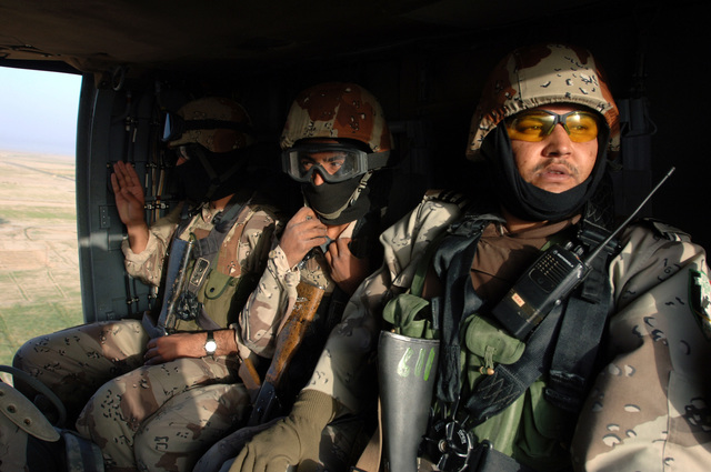 Iraqi Army and U.S. Army Soldiers from B Battery 3-320th Field Artillery Regiment, 101st Airborne Division ride in a black hawk helicopter during Operation Savage Strike in Forward Operating Base Remagen, Tikrit on April 30, 2006. The 101st Airborne Division is currently deployed in the Tikrit area and Northern Iraq on support of Operation Iraqi Freedom.(U.S. Army photo by SPC. Teddy Wade) (Released)