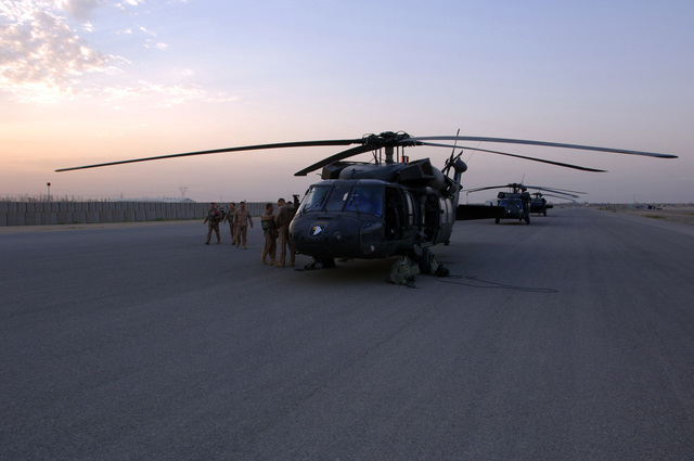 UH-60 Black Hawk helicopters from A Company, 5th Battalion, 101st Aviation Regiment stand by in preparation for an Air Assault operation with units from Forward Operating Base Remagen, Tikrit on April 30, 2006. Operation Savage Strike was conducted by Soldiers from 3-320th Field Artillery Regiment and Iraqi army soldiers. The 101st Airborne Division is currently deployed in the Tikrit area and Northern Iraq on support of Operation Iraqi Freedom. (U.S. Army photo by SPC. Teddy Wade) (Released)