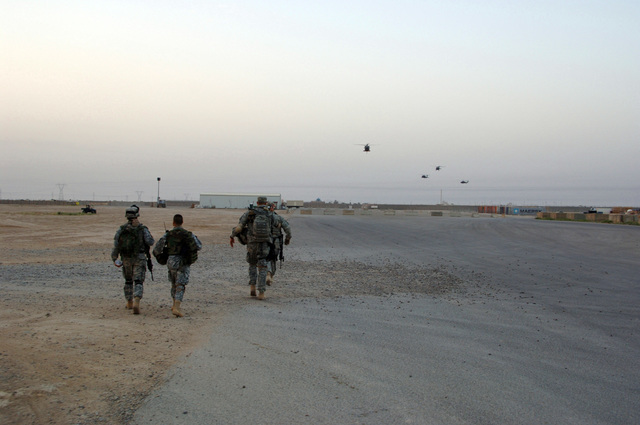 U.S. Army Soldiers from B Battery 3-320th Field Artillery Regiment, 101st Airborne Division prepare for an air assault mission out of Forward Operating Base Remagen, Tikrit on April 30, 2006. The 101st Airborne Division is currently deployed in the Tikrit area and Northern Iraq on support of Operation Iraqi Freedom. (U.S. Army photo by SPC. Teddy Wade) (Released)