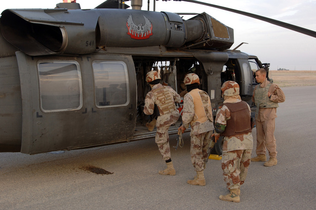U.S. Army Soldiers from B Battery 3-320th Field Artillery Regiment, 101st Airborne Division and Iraqi soldiers rehearse the proper upload procedures in a black hawk helicopter before conducting Operation Savage Strike in Forward Operating Base Remagen, Tikrit on April 30, 2006.   The 101st Airborne Division is currently deployed in the Tikrit area and Northern Iraq on support of Operation Iraqi Freedom.(U.S. Army photo by SPC. Teddy Wade) (Released)