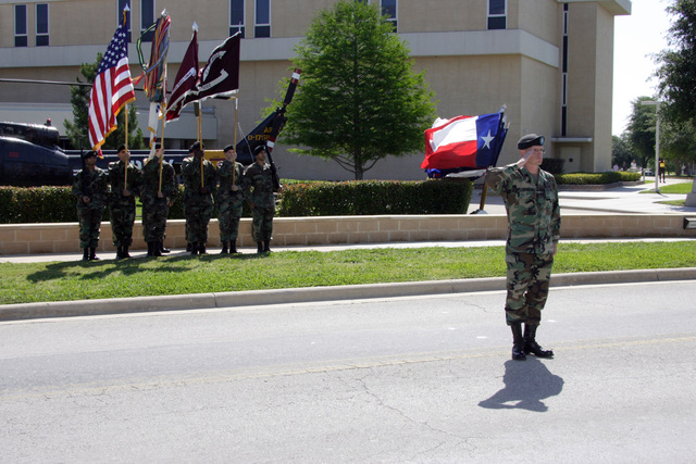 U.S. Army LT. COL. R. G. Dickinson (foreground), Commnader, Troop Command, salutes during the playing of the national anthem at the redesignation ceremony of the Darnell Army Community Hospital to the Carl. R. Darnell Army Medical Center at Fort Hood, Texas, on May 1, 2006.  (U.S. Army photo by John Byerly) (Released)