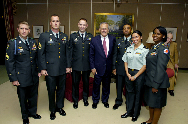 The Honorable Donald H. Rumsfeld (center), U.S. Secretary of Defense, poses for photos with members of the Georgia Army National Guard at the History Center in Atlanta, Ga., on May 4, 2006. (DoD photo by PETTY Officer 1ST Class Chad J. McNeeley) (Released)
