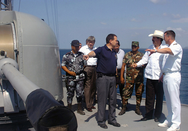 The President of the Republic of Honduras (HND), Jose Manuel Zelaya listens as US Navy (USN) Commander (CDR) Roderick Fraser, explains the operations of an MK 75 rapid fire gun aboard the USN Oliver Hazard-class guided missile frigate USS UNDERWOOD (FFG 36).  President Zelaya toured UNDERWOOD and thanked the crew for their outstanding community relation's efforts in Puerto Castilla, Honduras (HDS)