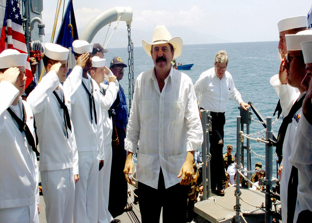 The President of the Republic of Honduras (HND), Jose Manuel Zelaya, receives honors from US Navy (USN) Sideboys aboard the USN Oliver Hazard-class guided missile frigate USS UNDERWOOD (FFG 36). President Zelaya toured UNDERWOOD and thanked the crew for their outstanding community relation's efforts in Puerto Castilla, Honduras (HDS)
