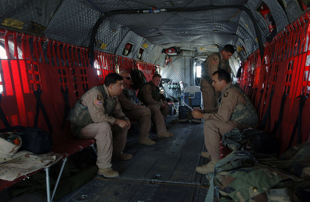 The U.S. Army CH-47 Chinook helicopter aircrew, Bravo Company, 6th Battalion, 101st Command Aviation Brigade, 101st Airborne Division (Air Assault), conducts a pre-mission brief inside the aircraft at Forward Operating Base Remagen, Tikrit, Salah ad Din Province, Iraq, on May 7, 2006, in support of Operation Iraqi Freedom.  (U.S. Army photo by SPEC. Teddy Wade) (Released)